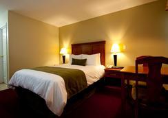 Riverland Inn & Suites - Kamloops - 睡房