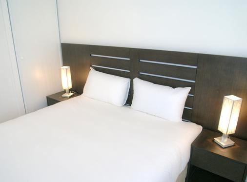 利伯特瓦纳中央公寓式酒店 - 瓦纳 - 睡房