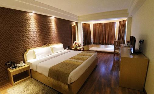 迪伊商标酒店度假村 - 新德里 - 睡房