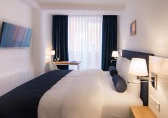 拜耳韦瓦第酒店 - 慕尼黑 - 睡房
