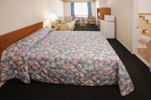 雄伟酒店和公寓 - 大洋城 - 睡房