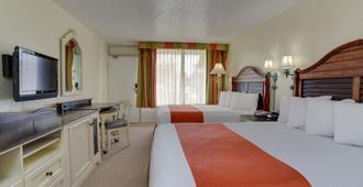 瑟诺拉酒店及套房 - 正门东 - 基西米 - 睡房