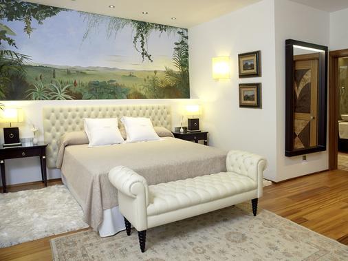 米拉多达特酒店 - 伊维萨镇 - 睡房