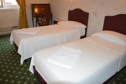 罗马德克萨斯酒店 - 罗马 - 睡房