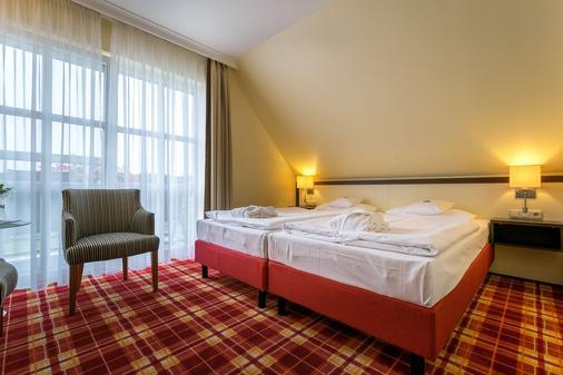 百慕森 - 酒店•高尔夫•Spa - 塞巴特黑灵斯多夫 - 睡房
