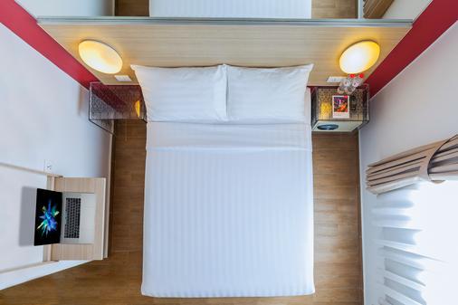 巨港红色星球 - 巨港 - 睡房