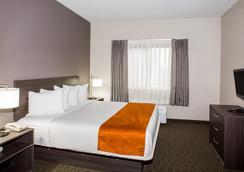 奥兰多机场戴斯套房酒店 - 奥兰多 - 睡房