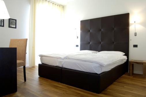 梅里蒂安娜酒店 - 马尔切西内 - 睡房