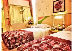 德沃纳酒店 - 玛琅 - 睡房