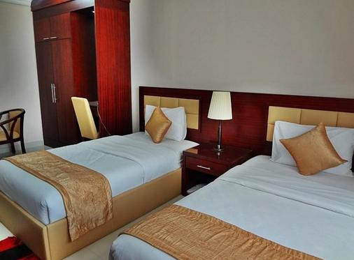 哈拉公寓酒店 - 阿吉曼 - 睡房