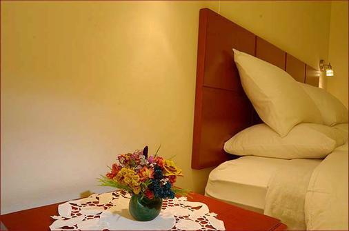 金印加酒店 - 库斯科 - 睡房