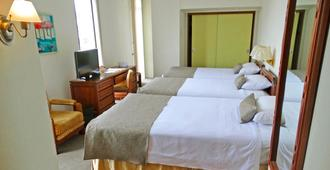 大陆酒店 - 瓜亚基尔 - 睡房