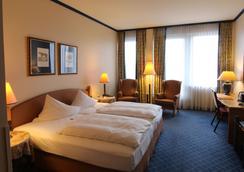 诗威林阿梅迪亚酒店贝斯特韦斯特精选修尔广场酒店 - 什未林 - 睡房