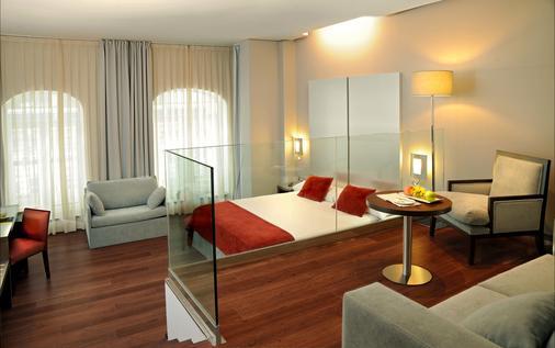 库里森斯考特尔酒店 - 毕尔巴鄂 - 睡房