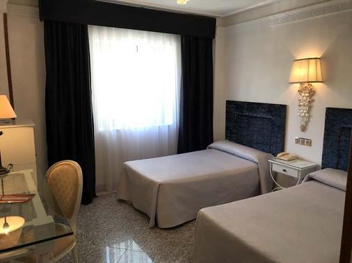 萨拉曼卡阿特尤斯卡梅丽塔斯酒店 - 萨拉曼卡 - 睡房