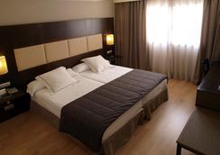 塞尔扣泰尔四柱酒店 - 阿维拉 - 睡房