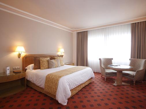 洛萨贝托豪华酒店 - 圣地亚哥-德孔波斯特拉 - 睡房
