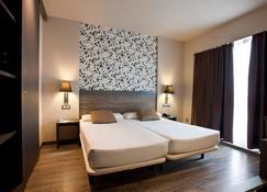 费里亚广场赛克特尔酒店 - 萨拉戈萨 - 睡房