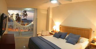 塞尔科蒂尔酒店集团塔马卡海滩度假村酒店 - 圣玛尔塔 - 睡房
