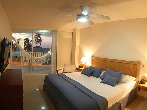 打马卡塞尔科蒂尔海滩度假酒店 - 圣玛尔塔 - 睡房
