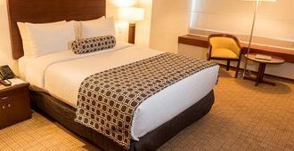 波哥大特肯达玛套房酒店 - 波哥大 - 睡房