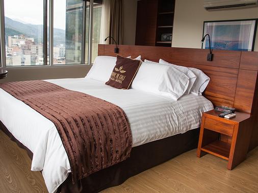 托雷卡利广场酒店 - 卡利 - 睡房