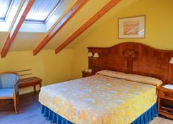 霍卢斯萨莫拉酒店 - 萨莫拉 - 睡房