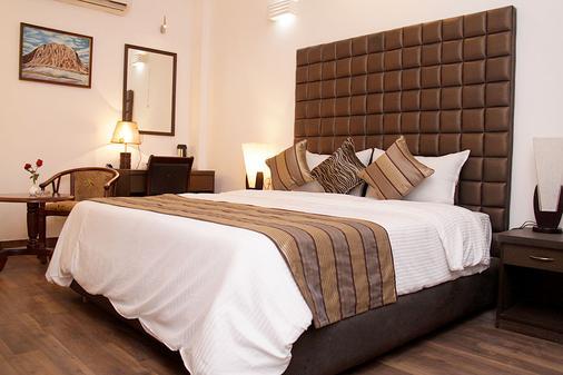 卡梅隆酒店 - 新德里 - 睡房