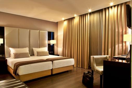 图里姆大街东方酒店 - 里斯本 - 睡房