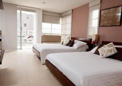 青色套房酒店 - 麦德林 - 睡房