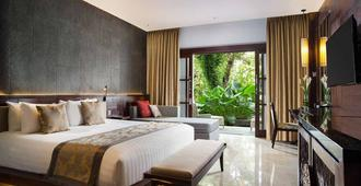 普瑞桑特瑞安酒店 - 登巴萨 - 睡房