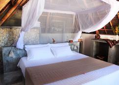 努尔海滩度假酒店 - Jambiani - 睡房