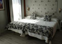 洛斯那然约斯酒店 - Cáceres - 睡房