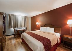 子午线红屋顶酒店 - 梅里迪恩 - 睡房