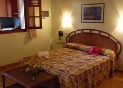 奥提苏克里尔赫酒店 - 皮特尔角城 - 睡房