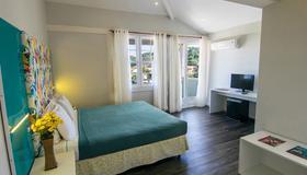 鲍萨达安罗马多马尔酒店 - 布希奥斯 - 睡房