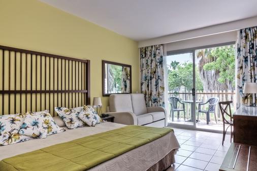 卡里布冒险港公园酒店 - 包括冒险港公园门票 - 萨洛 - 睡房