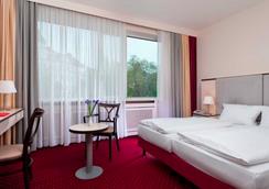 柏林选帝侯大街卡姆酒店 - 柏林 - 睡房