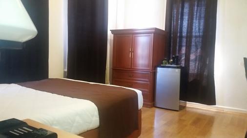东西酒店 - 洛杉矶 - 睡房