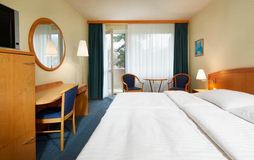 维罗纳2欧莱酒店 - 布尔诺 - 睡房