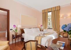 安巴夏特利宫酒店 - 罗马 - 睡房