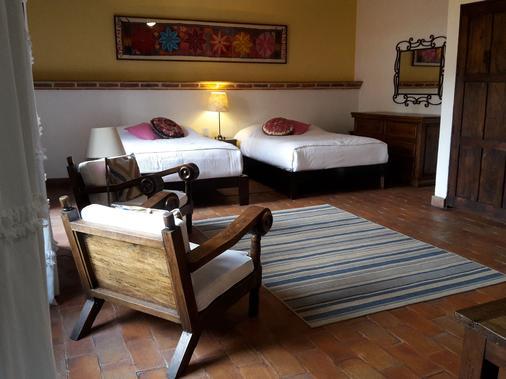 科里奥民宿酒店 - 圣米格尔-德阿连德 - 睡房