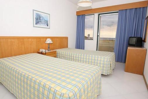 阿尔加维莫旅行公寓酒店 - 波尔蒂芒 - 睡房