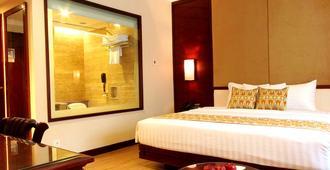 卡迪卡展特拉酒店 - 南雅加达 - 睡房