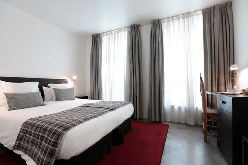 巴黎布丽泽尔酒店 - 巴黎 - 睡房
