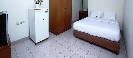 卡莱特佩度林纳3号@红门优质酒店 - 南雅加达 - 睡房