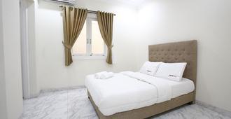 旁多克槟榔 2 号瑞德多兹酒店 - 南雅加达 - 睡房
