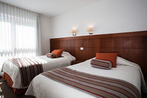 卡米诺里尔市中心酒店 - 拉巴斯 - 睡房