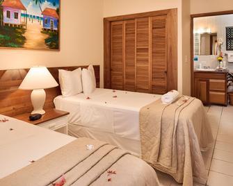 阳光煦风套房酒店 - 圣佩德罗 - 睡房