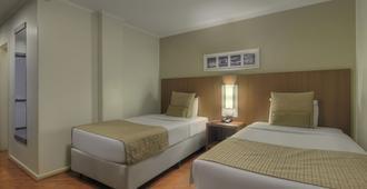 库里提巴德维尔商务酒店 - 库里提巴 - 睡房